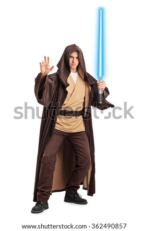 Full length portrait of a young man with a brown hooded cape and a laser sword isolated on white background