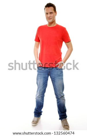 Full length portrait of a young man with hands in pockets , isolated on white background - stock photo