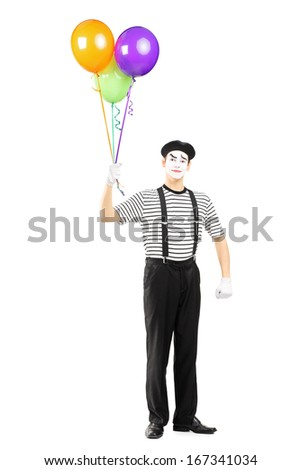Full length portrait of a young mime artist holding balloons and looking at camera isolated on white background