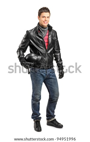 Full length portrait of a young motorcycler holding a helmet posing isolated on white background - stock photo