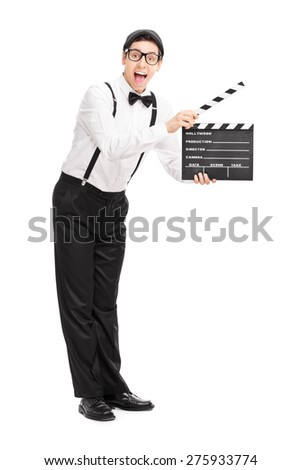 Full length portrait of a young movie director holding a clapperboard and looking at the camera isolated on white background - stock photo