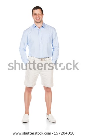 Full length portrait of a young professional adult male wearing a blue buttoned shirt and beige shorts. Image is isolated on a white background. - stock photo