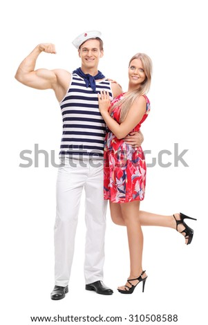 Full length portrait of a young sailor flexing his bicep and posing together with his girlfriend isolated on white background