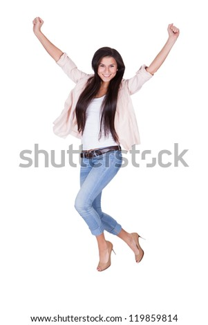 Full length portrait of a young shapely beautiful woman in trendy casual clothing waving her arms in the air isolated on white