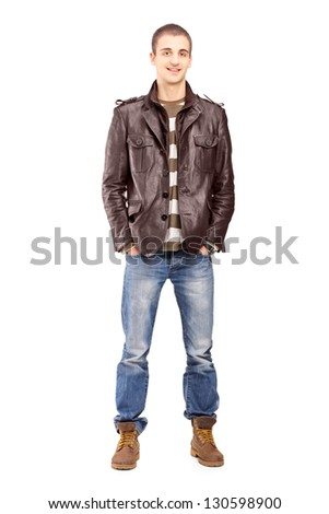 Full length portrait of a young smiling man posing isolated on white background - stock photo