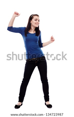 Full length portrait of a young woman dancing isolated on white background