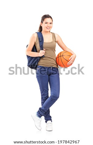 Full length portrait of a young woman holding a basketball isolated on white background