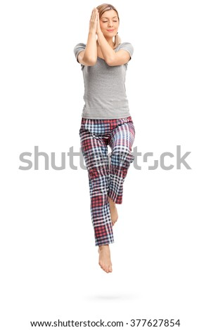 Full length portrait of a young woman peacefully sleeping shot in mid-air isolated on white background - stock photo