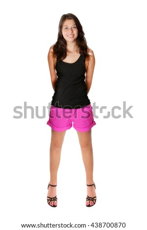 Full length portrait of a young woman with a beautiful smiling face, she's wearing pink shorts and a black shirt in front of white studio background - stock photo