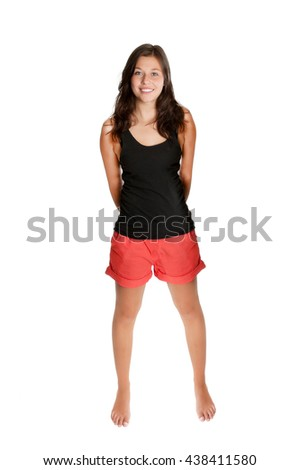 Full length portrait of a young woman with a beautiful smiling face, she's wearing red shorts and black shirt in front of white studio background - stock photo