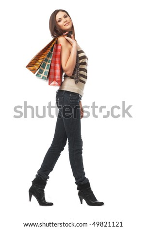 Full length portrait of a young woman with bags over white - stock photo