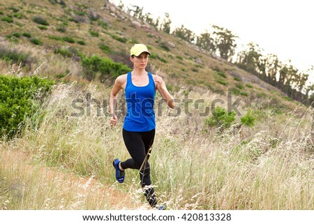 Full length portrait of active older woman running in nature - stock photo
