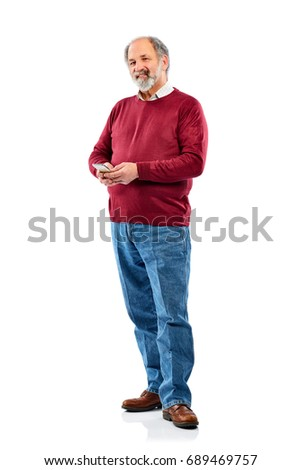 Full length portrait of active senior man using cell phone and looking at camera white background
