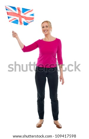 Full length portrait of aged patriotic lady waving United Kingdom flag - stock photo