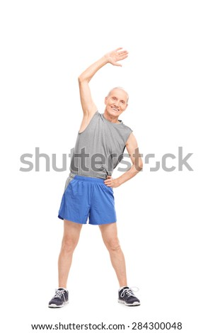 Full length portrait of an active senior doing stretching exercises and looking at the camera isolated on white background - stock photo