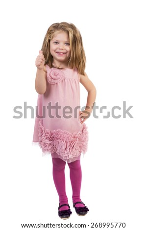 Full length portrait of an adorable little girl showing thumb up against white background - stock photo
