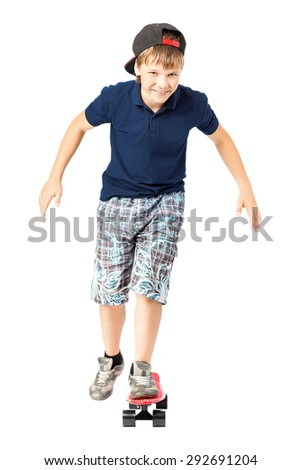 Full length portrait of an adorable teenager riding a skateboard isolated on white background