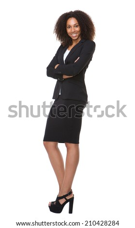 Full length portrait of an african american business woman smiling on isolated white background - stock photo
