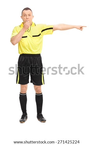Full length portrait of an angry football referee blowing a whistle and pointing with his hand isolated on white background - stock photo