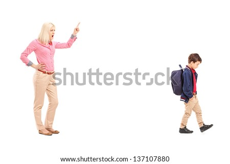 Full length portrait of an angry mother shouting at her son, isolated on white background