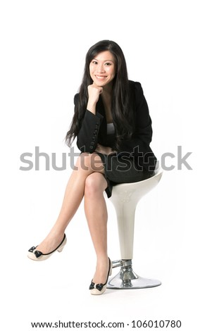 Full length portrait of an Asian Business woman sitting on a chair. Isolated on white background. - stock photo