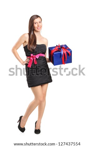 Full length portrait of an attractive smiling woman holding a gift isolated on white background