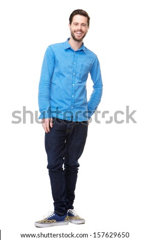 Full length portrait of an attractive young man laughing - stock photo