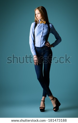 Full length portrait of an elegant girl model poses in blouse and bow tie. Refined style of old Europe. - stock photo
