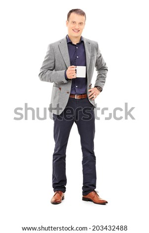 Full length portrait of an elegant man holding a coffee mug isolated on white background - stock photo