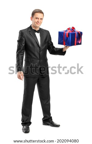 Full length portrait of an elegant man holding a present isolated on white background - stock photo