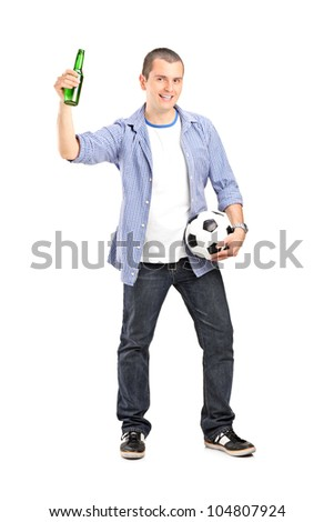 Full length portrait of an euphoric male fan holding a football and beer bottle isolated on white background - stock photo