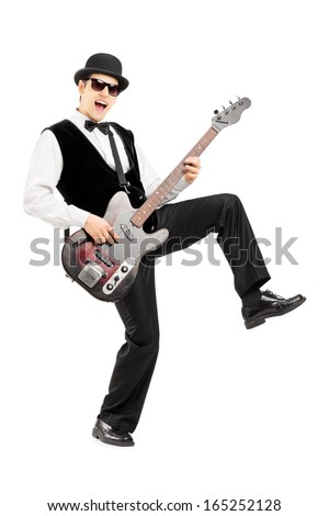 Full length portrait of an euphoric man playing a bass guitar isolated on white background