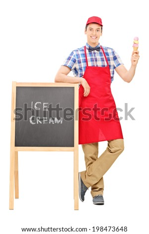 Full length portrait of an ice cream vendor standing by a blackboard isolated on white background - stock photo