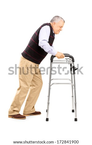 Full length portrait of an old man struggling to move with walker isolated on white background