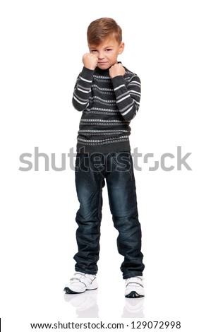 Full length portrait of anger boy with fists, isolated on white background - stock photo