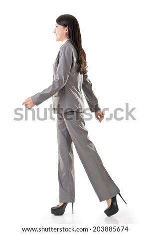 Full length portrait of Asian business woman walk, side view isolated on white background. - stock photo