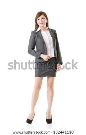 Full length portrait of Asian business woman wear skirt suit, isolated on white background. - stock photo