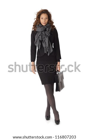 Full length portrait of attractive businesswoman in mini skirt over white background.