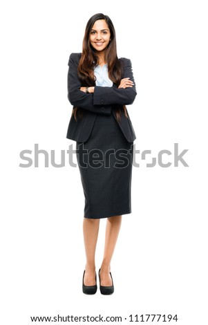 Full length portrait of attractive Indian businesswoman arms folded isolated on white background