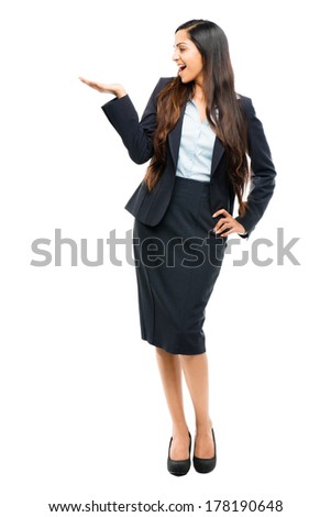 Full length portrait of attractive Indian businesswoman showing copy space on white background - stock photo