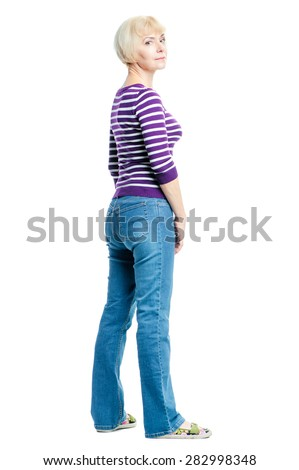 Full length portrait of attractive middle aged woman wearing casual. Back view. Isolated on white. - stock photo