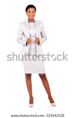 full length portrait of attractive young african business woman posing on white - stock photo