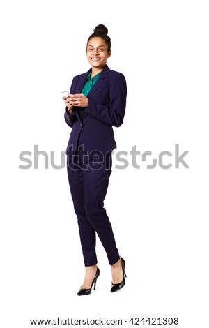 Full length portrait of attractive young business woman with a cell phone standing over white background - stock photo