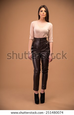 Full length portrait of attractive young woman in fashion cloth - stock photo