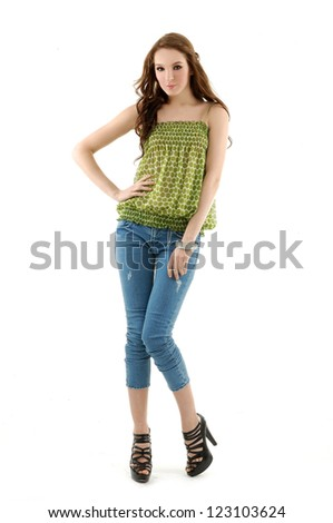 Full-length portrait of beautiful girl in jeans - stock photo