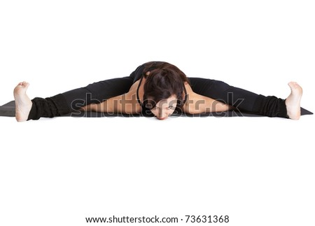 full-length portrait of beautiful woman doing the splits on fitness mat - stock photo