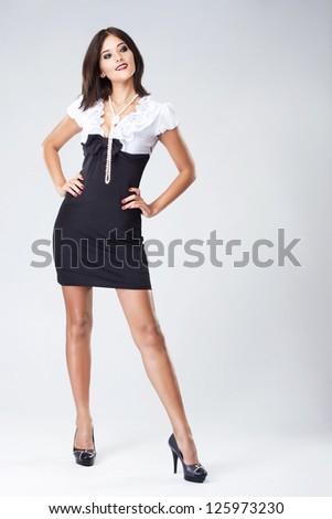 Full-length portrait of beautiful woman in elegant dress - stock photo