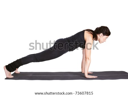 full-length portrait of beautiful woman pushing up on fitness mat in urdhva chaturanga dandasana pose - stock photo