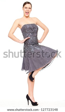 Full length portrait of beautiful woman standing against white background