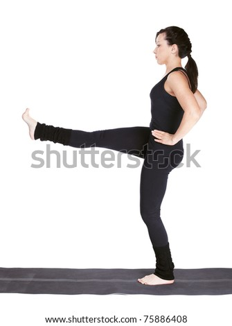 full-length portrait of beautiful woman working out yoga excercise utthita Parsva Sahitya on fitness mat - stock photo